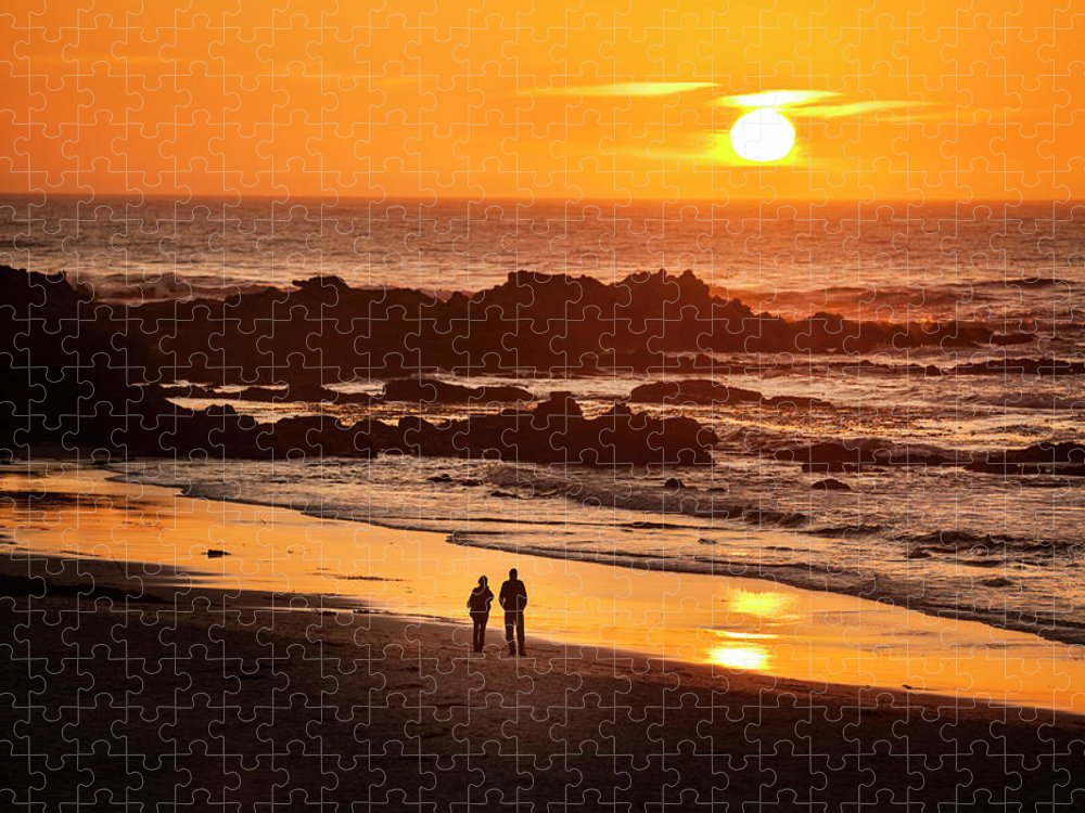 Scenics Puzzle featuring the photograph Couple Watch The Sunset At Carmel Beach by Pgiam