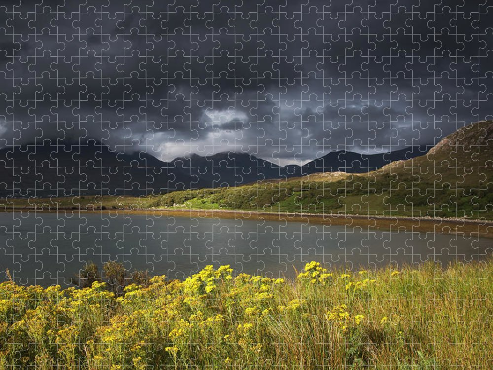 Tranquility Puzzle featuring the photograph Dark Storm Clouds Hang Over The by John Short / Design Pics