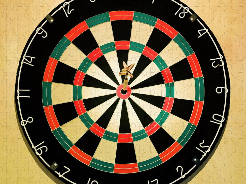 Expertise Puzzle featuring the photograph Dart In Bulls Eye On Dart Board by Fuse