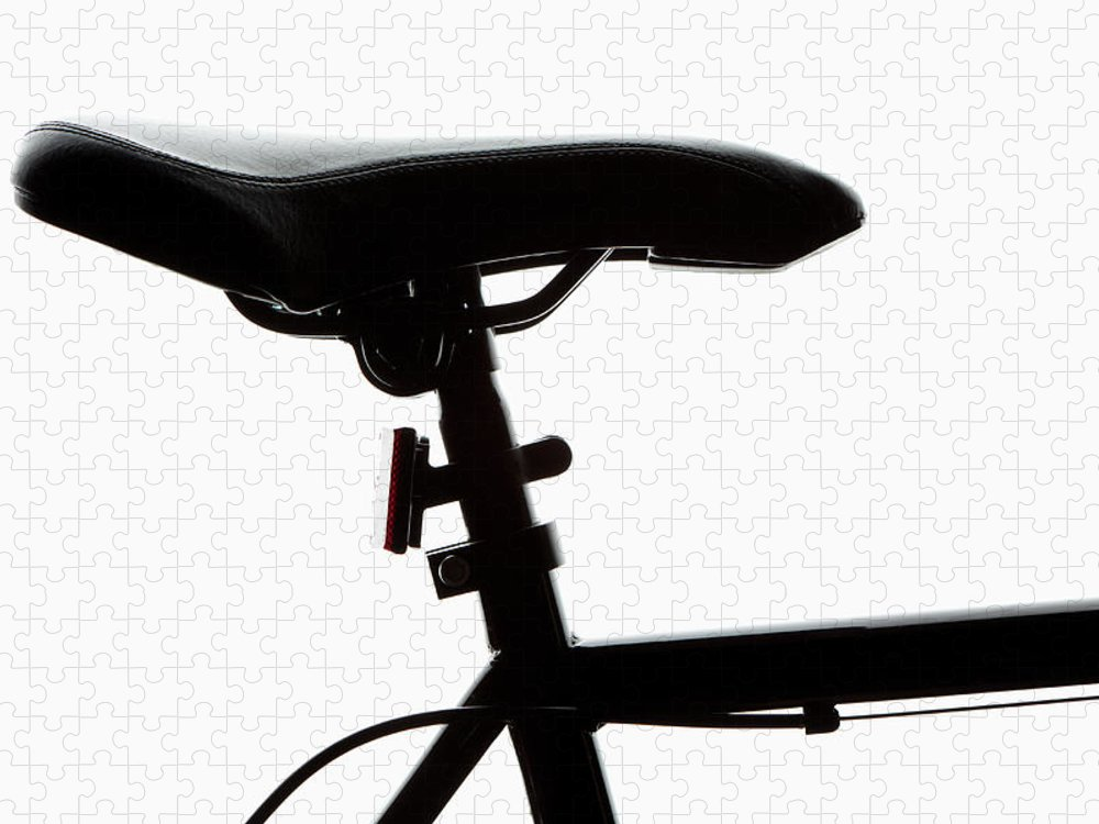 Bicycle Seat Puzzle featuring the photograph Detail Of A Bicycle Seat, Back Lit by Epoxydude
