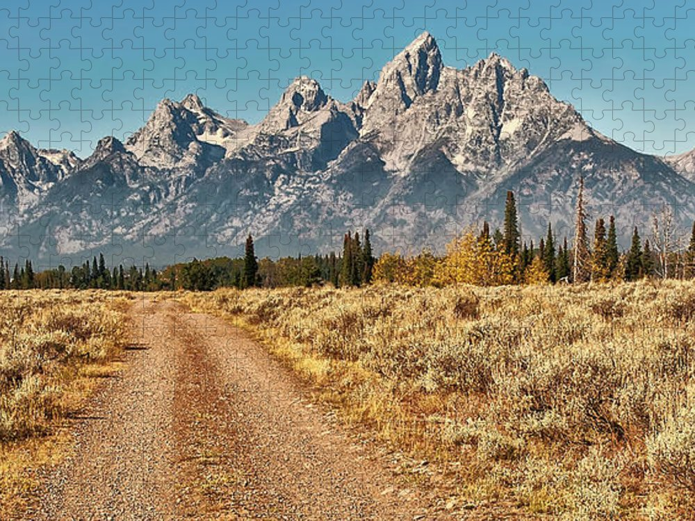 Tranquility Puzzle featuring the photograph Dirt Road To Tetons by Jeff R Clow