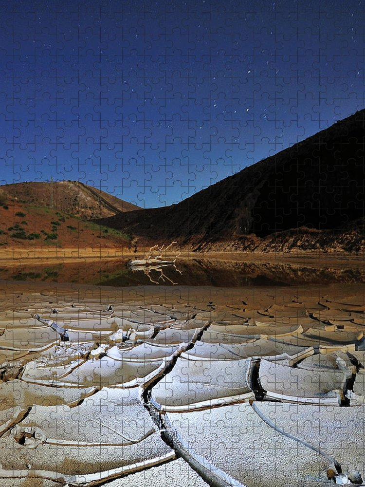Tranquility Puzzle featuring the photograph Dry Landscape With Stars And Mountains by Davidexuvia