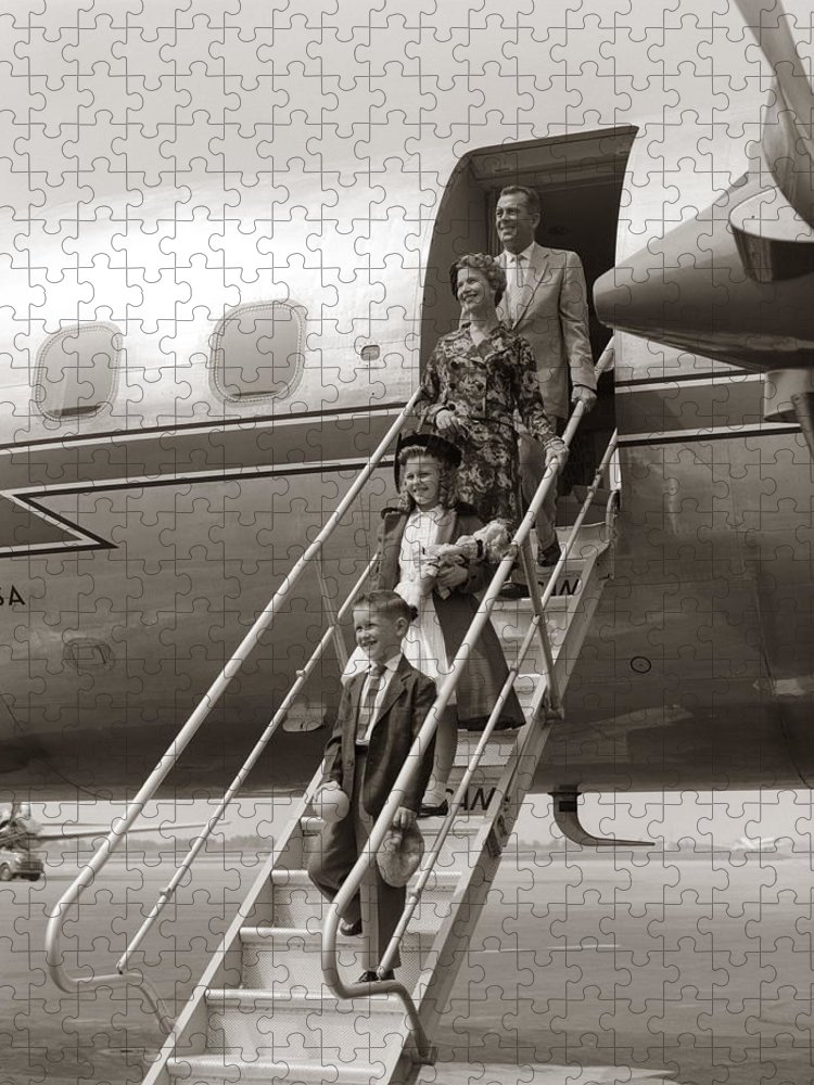 Steps Puzzle featuring the photograph Family Walking Down Airplane Stairs by H. Armstrong Roberts