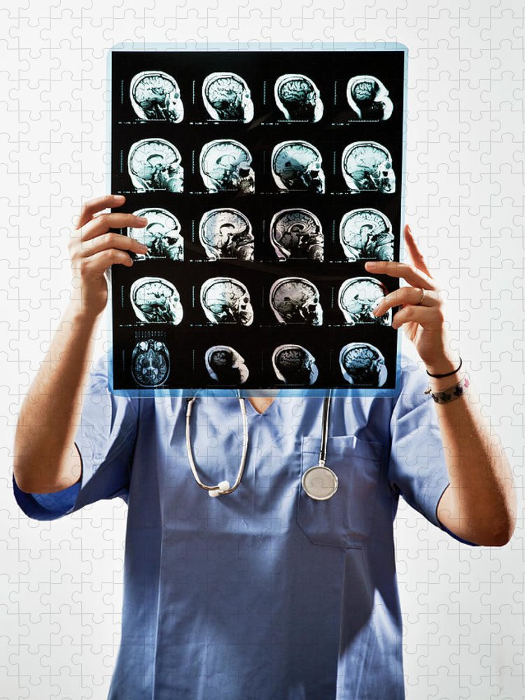 Expertise Puzzle featuring the photograph Female Doctor Holds Up Mri In Front Of by Ron Levine