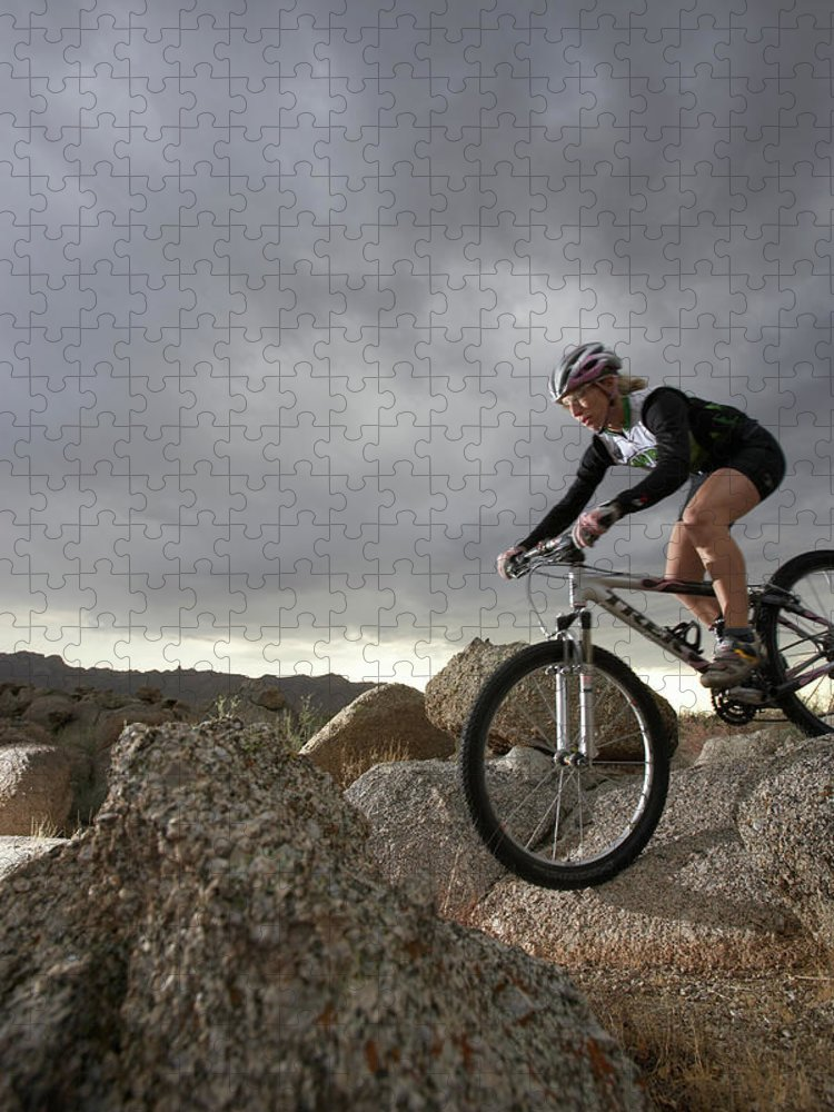 Sports Helmet Puzzle featuring the photograph Female Rider Mountain Biking Between by Thomas Northcut