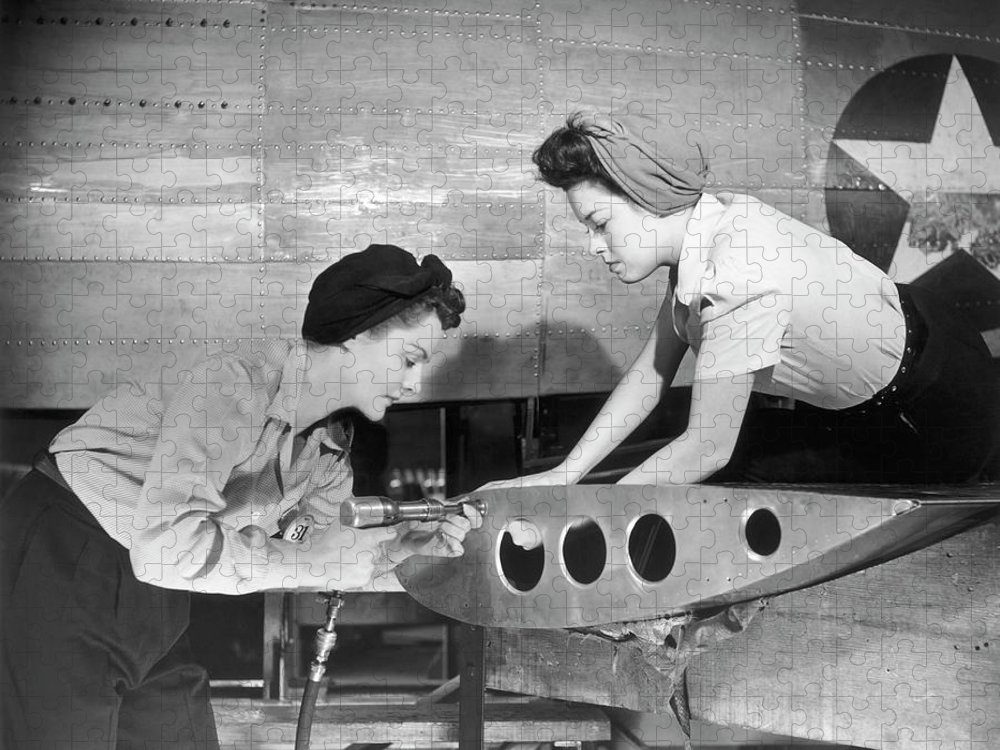 Working Puzzle featuring the photograph Female Workers Working On Plane by George Marks