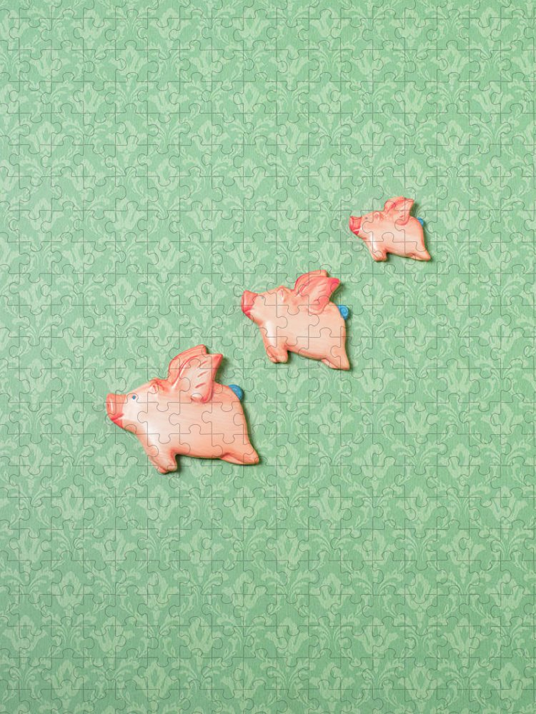 Disbelief Puzzle featuring the photograph Flying Pig Ornaments On Wallpapered by Peter Dazeley
