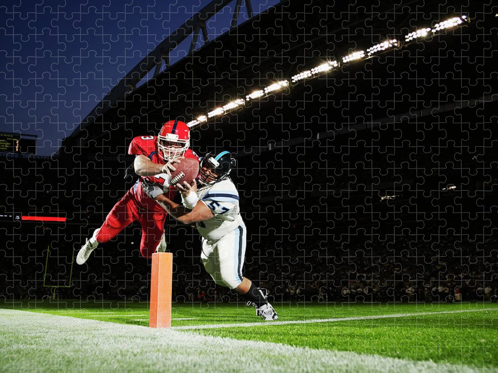 Sports Helmet Puzzle featuring the photograph Football Player Diving Into End Zone by Thomas Barwick
