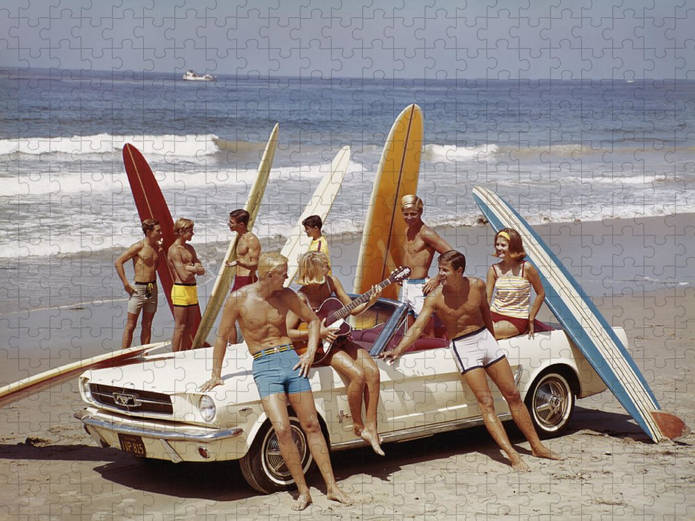 Young Men Puzzle featuring the photograph Friends Having Fun On Beach by Tom Kelley Archive