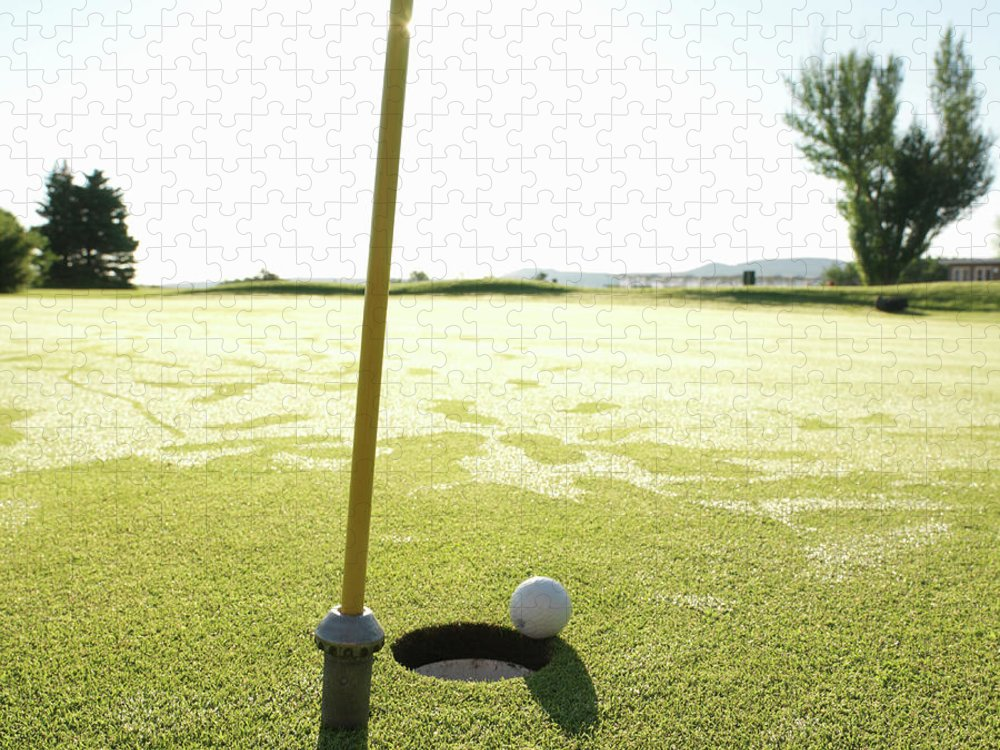 Grass Puzzle featuring the photograph Golf Ball Near Hole At Sunrise, High by Ascent/pks Media Inc.