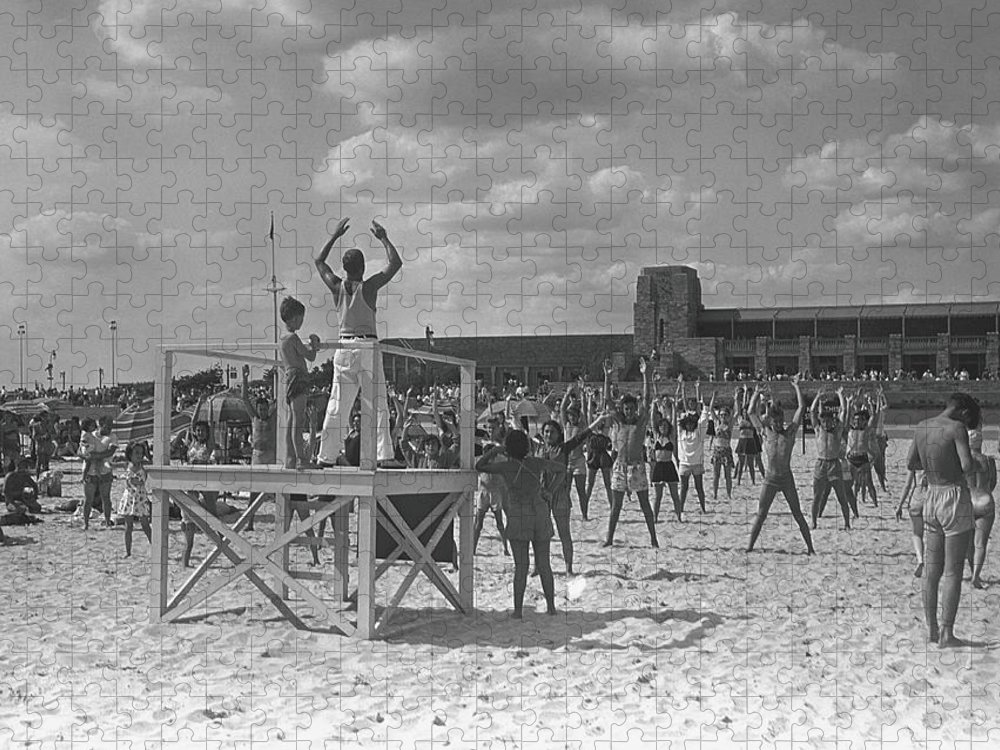 Human Arm Puzzle featuring the photograph Group Of People Exercising On Beach, B&w by George Marks
