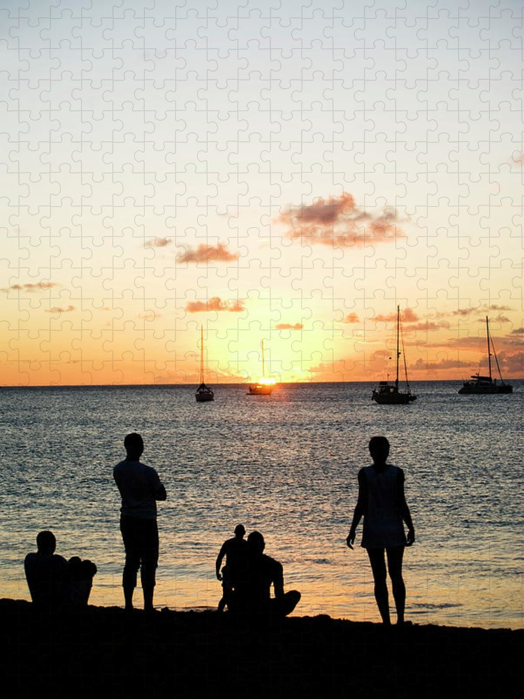 Recreational Pursuit Puzzle featuring the photograph Group Of Young Friends On Beach At by Jaminwell