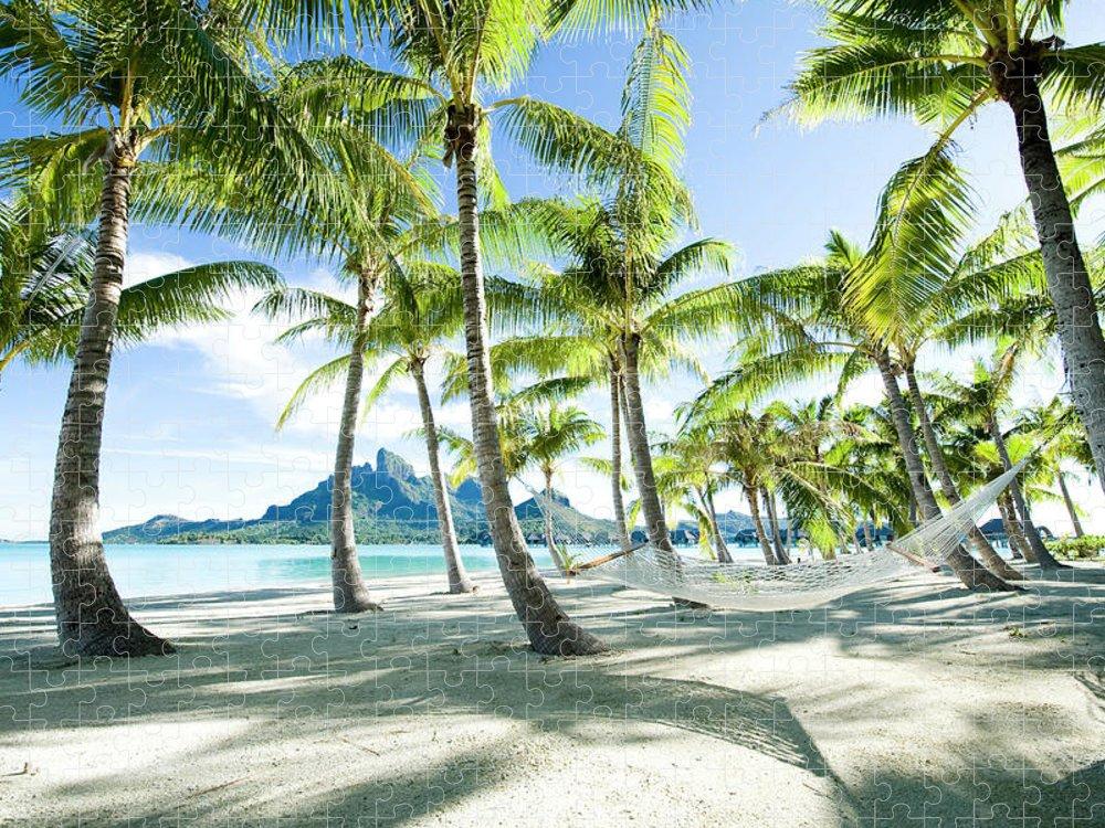Hanging Puzzle featuring the photograph Hammock At Bora Bora, Tahiti by Yusuke Okada/amanaimagesrf