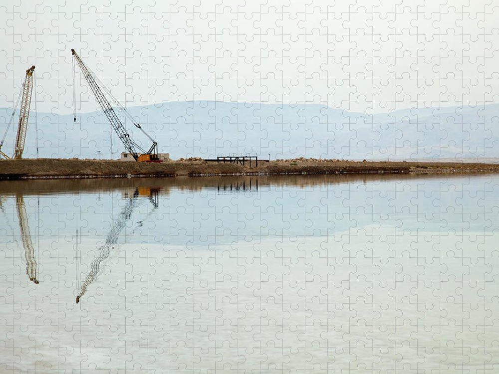 Working Puzzle featuring the photograph Heavy Machinery At The Dead Sea by Eldadcarin