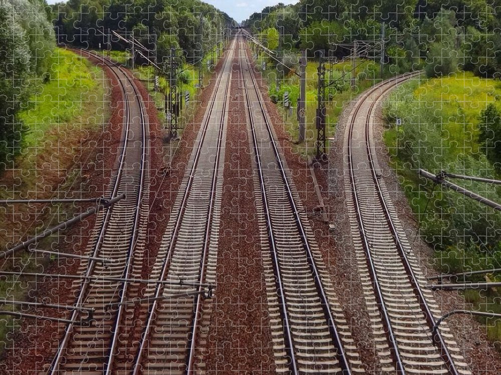 Tranquility Puzzle featuring the photograph High Angle View Of Empty Railroad Tracks by Thomas Albrecht / Eyeem
