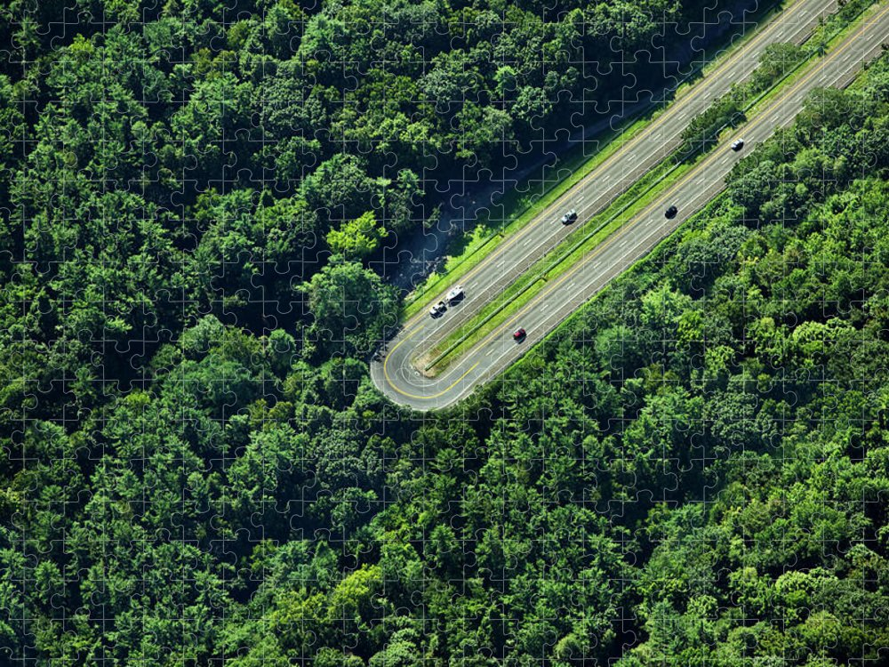 The End Puzzle featuring the photograph Highway U-turn In Forest by Thomas Jackson