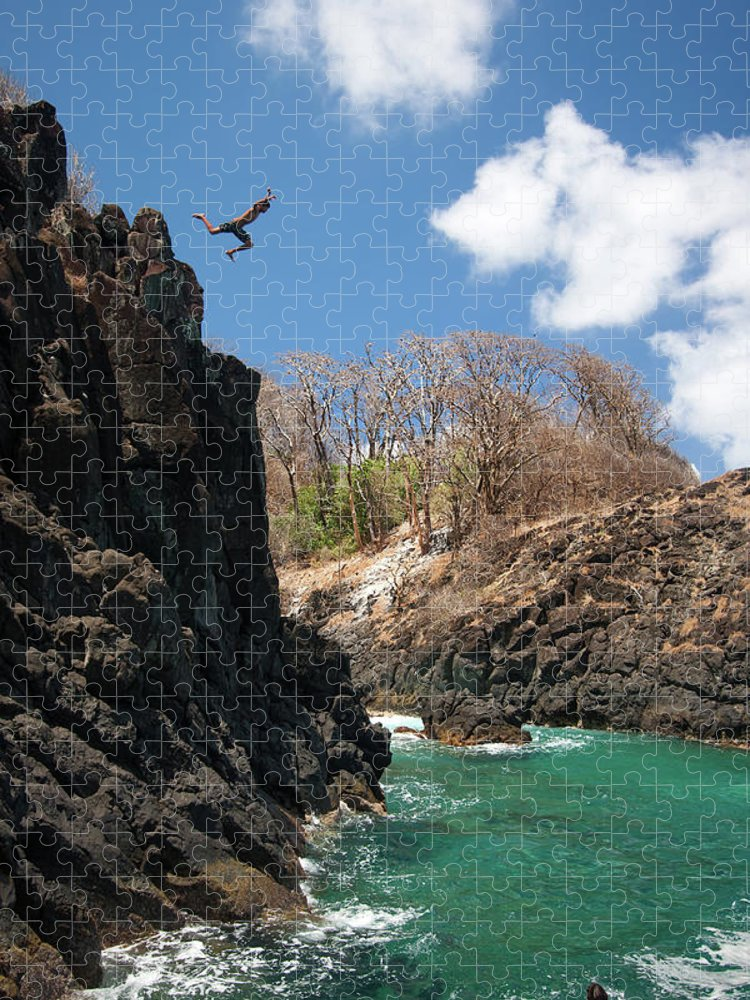 Tranquility Puzzle featuring the photograph Jumping by Mauricio M Favero