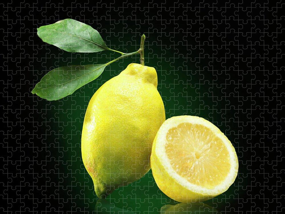 Black Background Puzzle featuring the photograph Lemon Slice by Jeremy Hudson