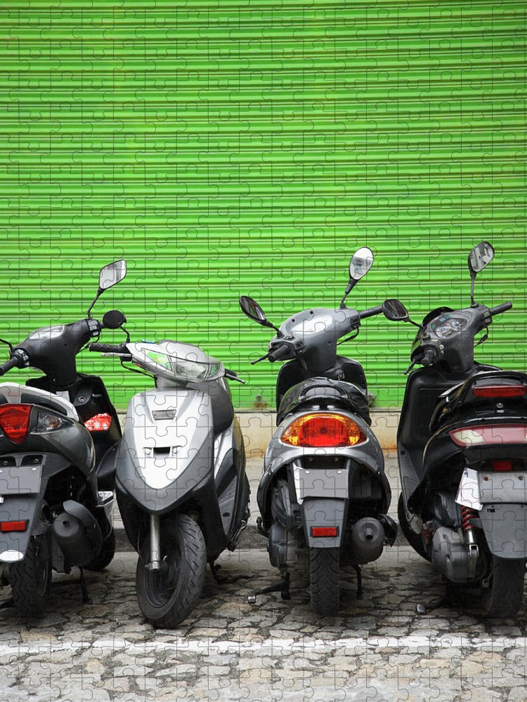 Macao Puzzle featuring the photograph Line Of Motorbikes Against Green by Steven Puetzer