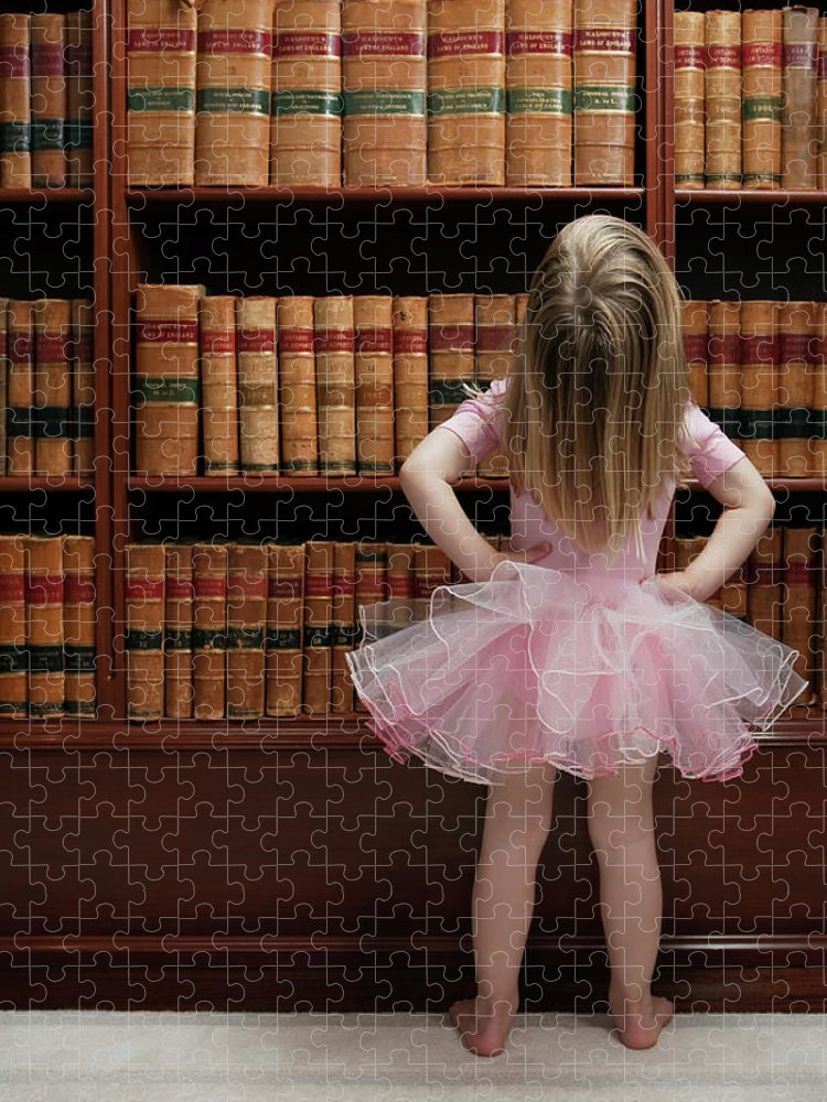 Education Puzzle featuring the photograph Little Girl In Tutu Reading Book Covers by Compassionate Eye Foundation/barry Calhoun