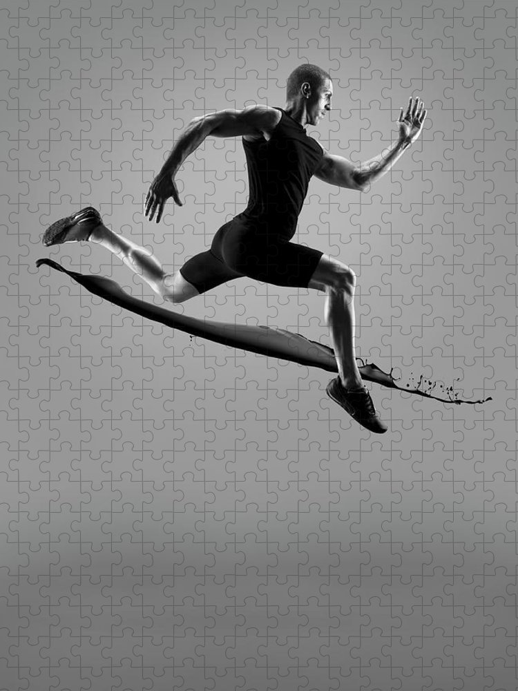 People Puzzle featuring the photograph Male Athlete Running Above Liquid Splash by Jonathan Knowles