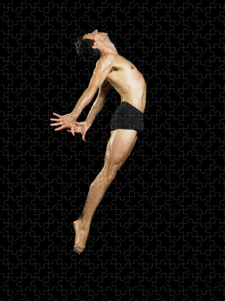 Human Arm Puzzle featuring the photograph Male Dancer Jumping by Image Source