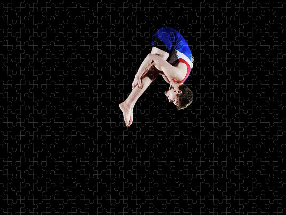 Focus Puzzle featuring the photograph Male Gymnast 16-17 Mid Air, Black by Thomas Barwick