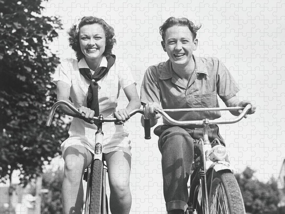 Young Men Puzzle featuring the photograph Man And Woman Riding Bikes, B&w, Low by George Marks