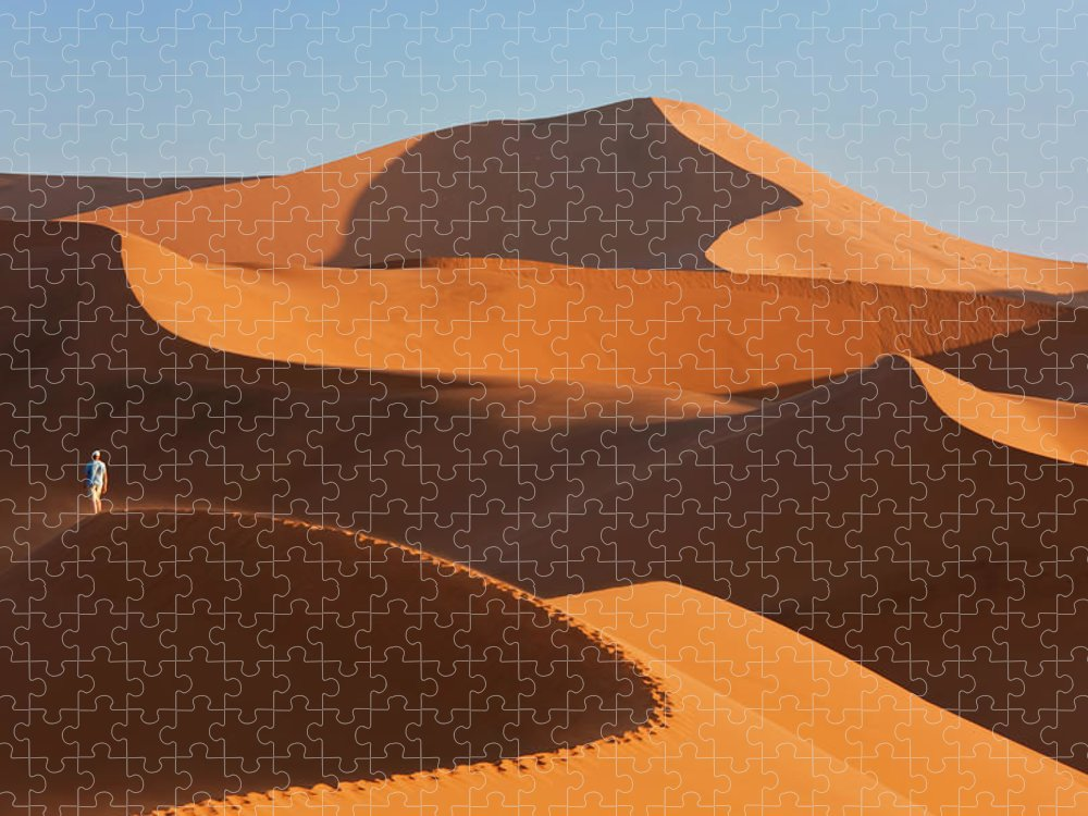 Shadow Puzzle featuring the photograph Man Climbing Sand Dunes, Namib Desert by Peter Adams