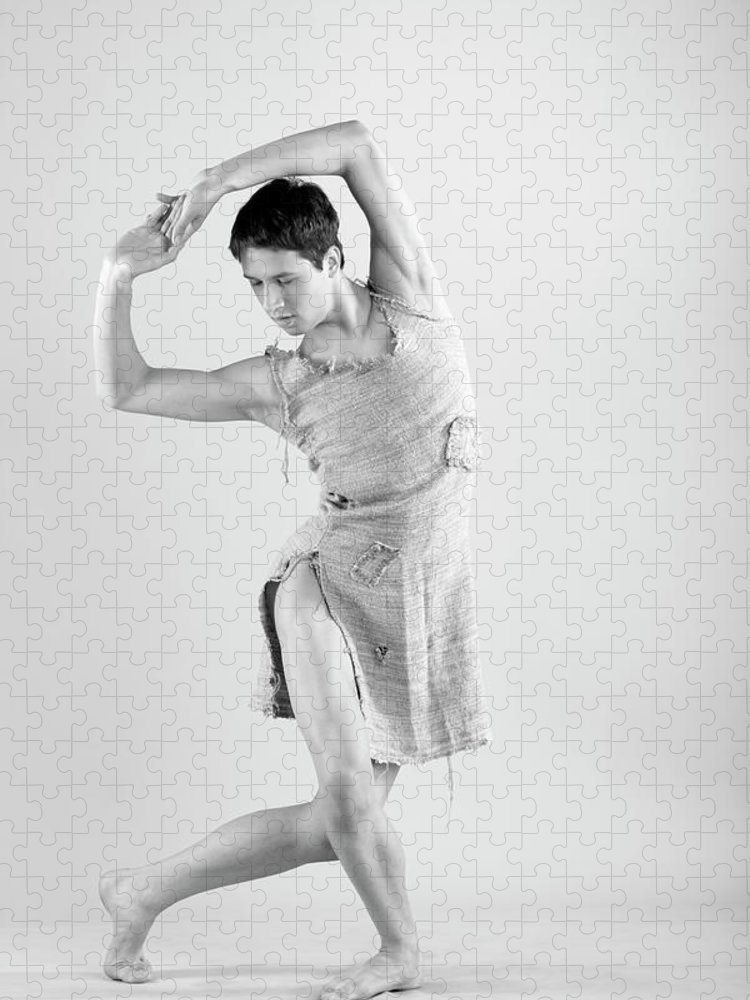 Ballet Dancer Puzzle featuring the photograph Man Dance by Oleg66