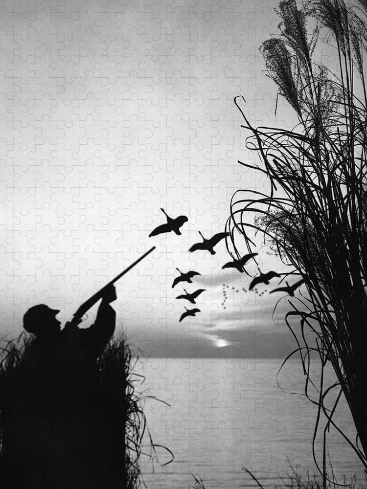 Rifle Puzzle featuring the photograph Man Duck-hunting by Stockbyte
