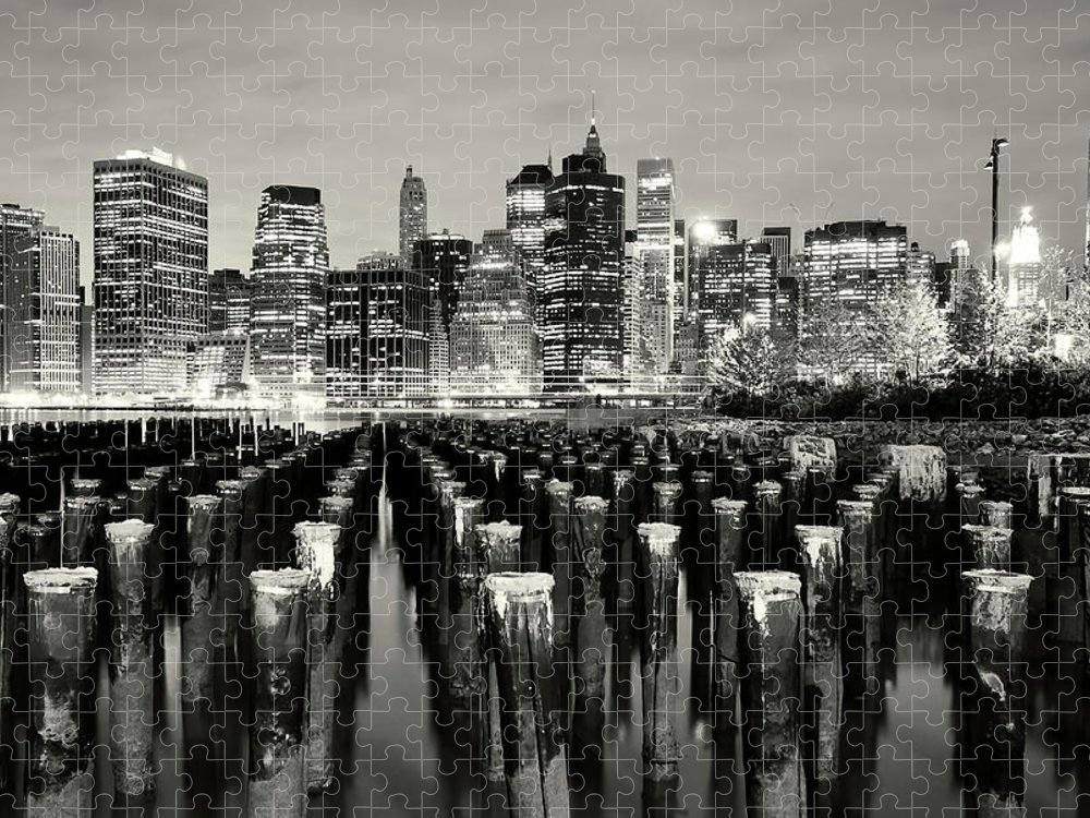 Wooden Post Puzzle featuring the photograph Manhattan At Night by Shobeir Ansari