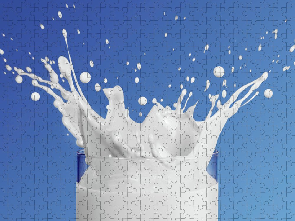 Milk Puzzle featuring the photograph Milk Splashing Into Glass by Terry Mccormick