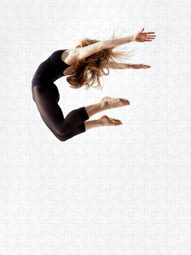 Human Arm Puzzle featuring the photograph Modern Dancer Jumping In The Air by Jonya