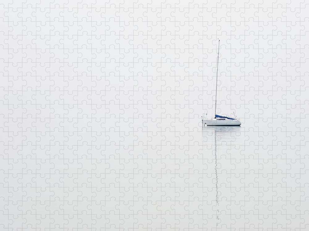 Sailboat Puzzle featuring the photograph Moored Sailboat On Lake Garda by Martin Ruegner