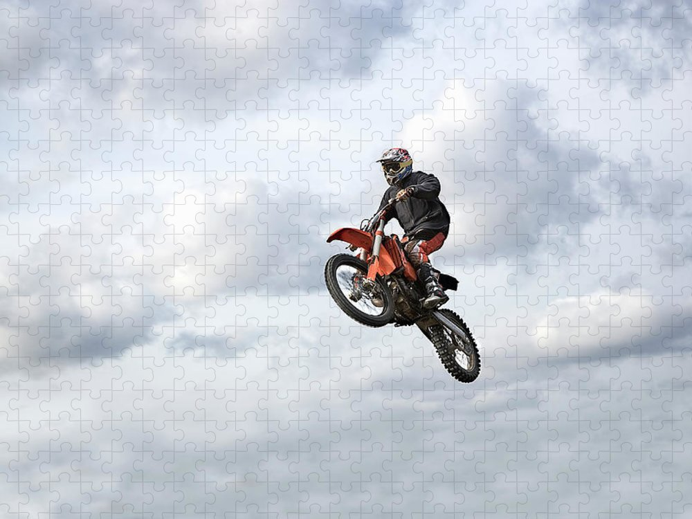 Recreational Pursuit Puzzle featuring the photograph Motocross Rider In Mid-air, Low Angle by Claus Christensen