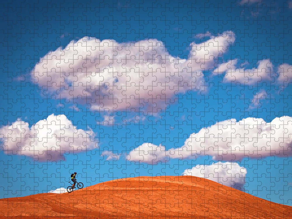 Slickrock Trail Puzzle featuring the photograph Mountain Biker Climbing On Slick Rock by Visualcommunications