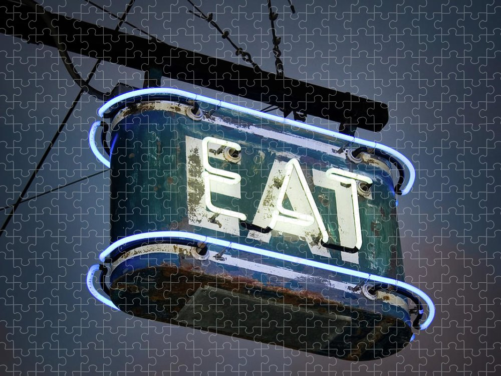 Hanging Puzzle featuring the photograph Neon Eat Sign by Kjohansen