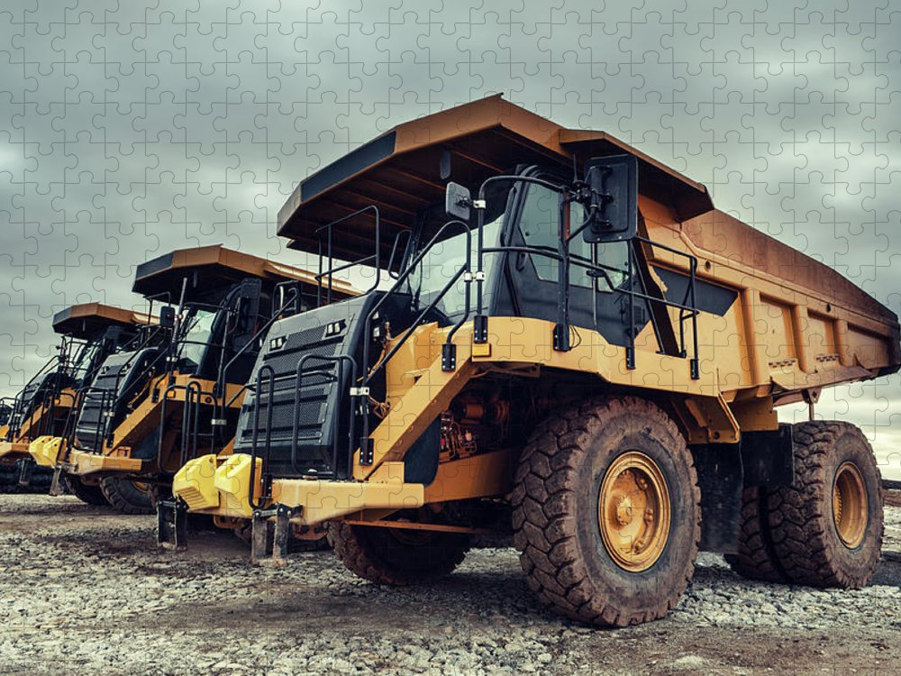 Construction Machinery Puzzle featuring the photograph Off-highway Dump Trucks by Shaunl