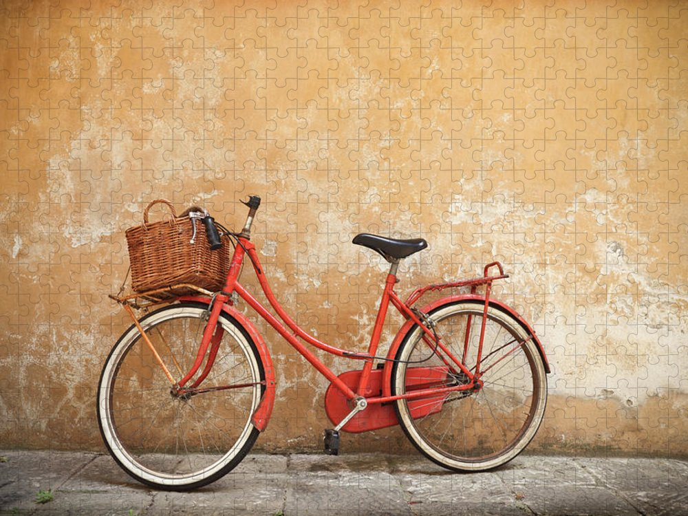 Leaning Puzzle featuring the photograph Old Red Bike Against A Yellow Wall In by Romaoslo