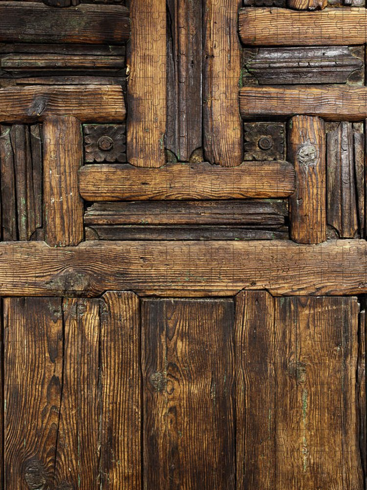 Arch Puzzle featuring the photograph Old Wooden Door by Logosstock