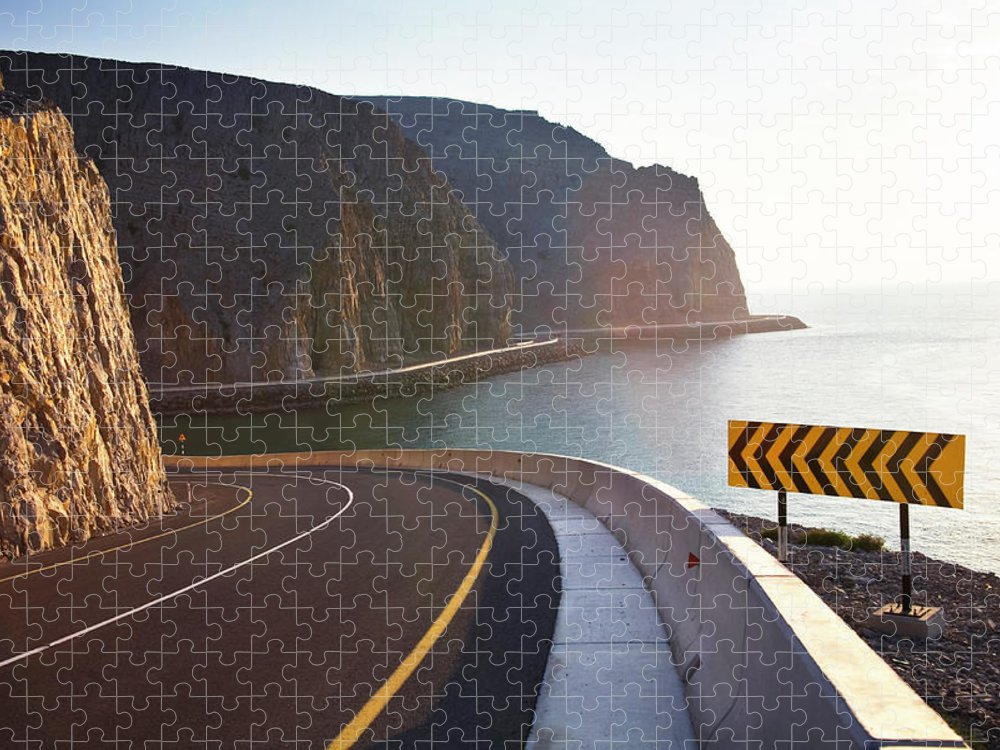 Curve Puzzle featuring the photograph Oman, Khasab, Road Round Mountain By by Christian Adams