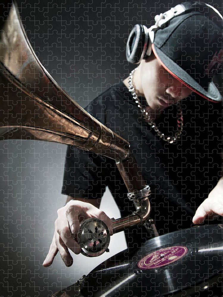 Youth Culture Puzzle featuring the photograph Oriental Dj Using Old Gramophone To Mix by Justin Lambert