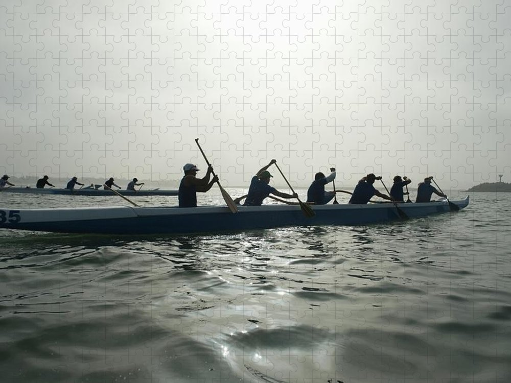 Sport Rowing Puzzle featuring the photograph Outrigger Canoeing Team Compete by Moodboard