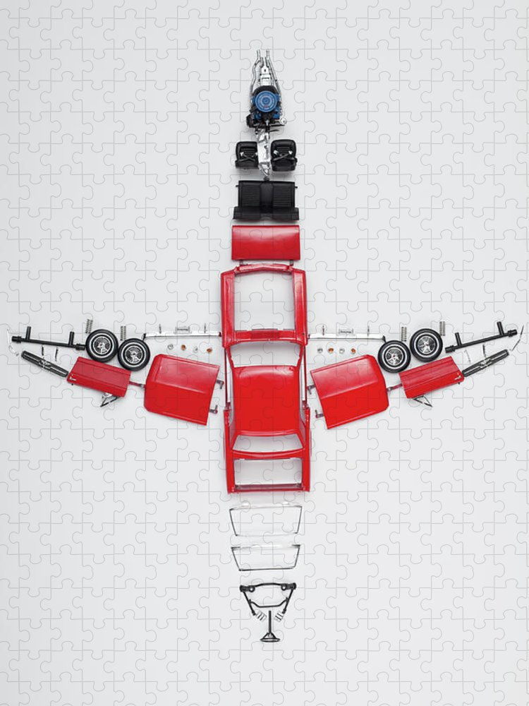 White Background Puzzle featuring the photograph Parts Of A Model Car Arranged In The by Larry Washburn