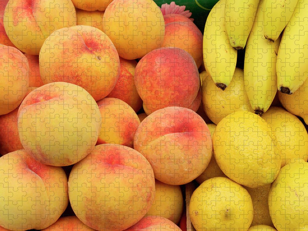 Retail Puzzle featuring the photograph Peaches, Lemons And Bananas At Farmers by Travelif