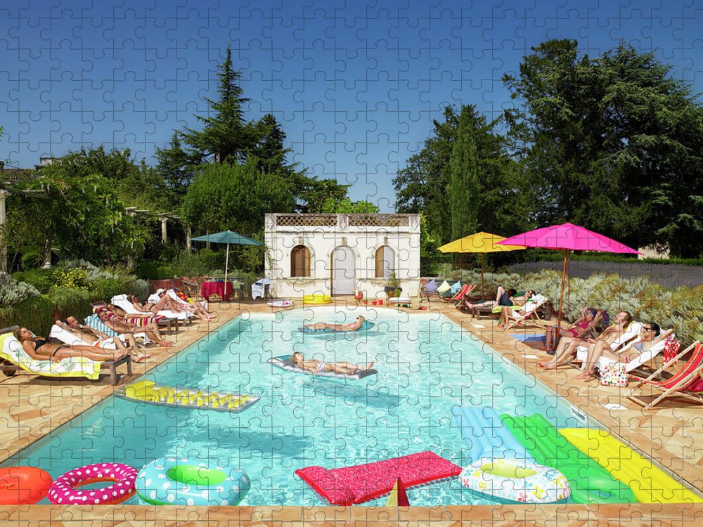 Young Men Puzzle featuring the photograph People Enjoying Summer Around The Pool by Ghislain & Marie David De Lossy