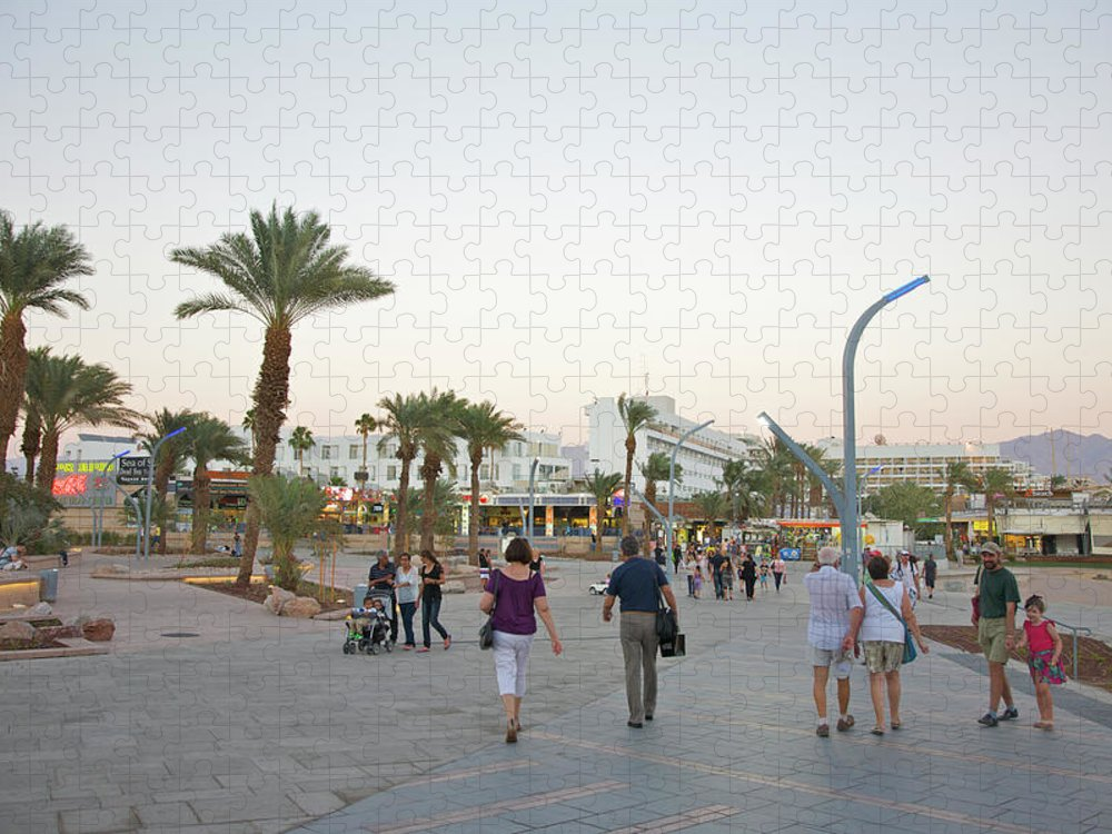 Child Puzzle featuring the photograph People Walking On Stone Plaza Near Palm by Barry Winiker