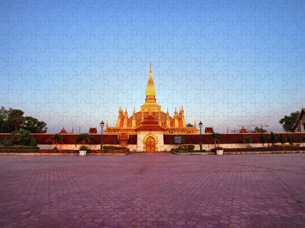 Monument Puzzle featuring the photograph Pha That Luang Stupa At Sunset by Fototrav