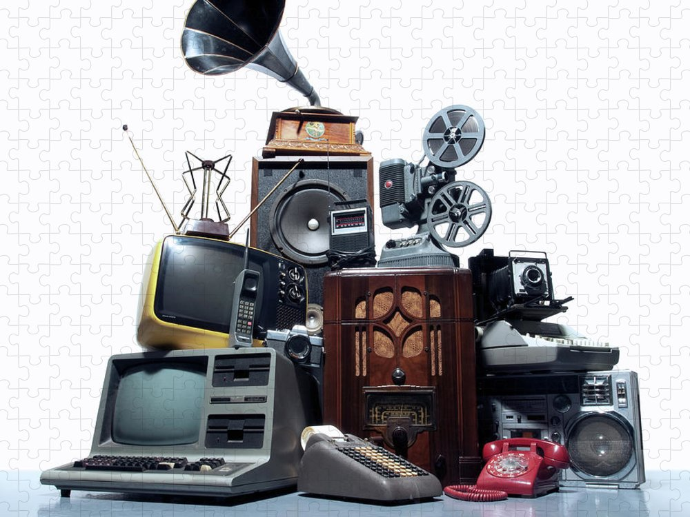 White Background Puzzle featuring the photograph Pile Of Old Technology by Pm Images